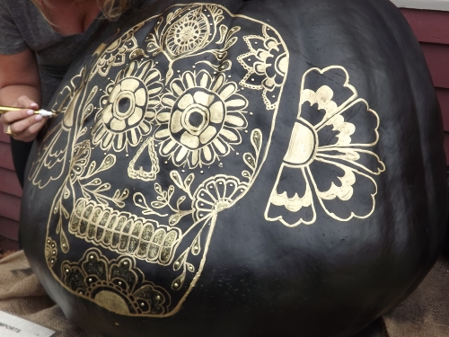 """Outside a jewelry store, this """"Day of the Dead"""" theme is continued on the jewelry for sale inside."""