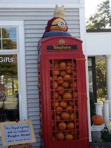 A minion atop a crowded phone booth. Baffling message but interesting concept.